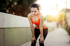 Tired jogger stopping to rest Royalty Free Stock Image
