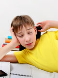Tired Kid with a Books Stock Image