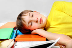 Tired Kid sleep on the Books Royalty Free Stock Photos