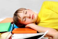 Tired Kid sleep on the Books Royalty Free Stock Photos