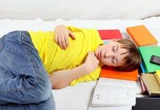 Tired Kid sleep on the Books Stock Photos