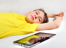 Tired Kid and Tablet Computer Stock Images