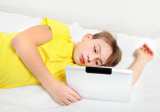 Tired Kid and Tablet Computer Royalty Free Stock Image