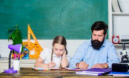 Tired kid unmotivated study learn. Private lesson. Homeschooling with father. School teacher and schoolgirl. Man bearded