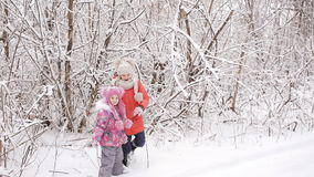 Tired kids got out of a snow-covered forest. Children find their way home stock video footage