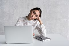 Tired lady sleeping at workplace royalty free stock photo