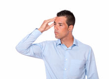 Tired latin man with headache standing Stock Images