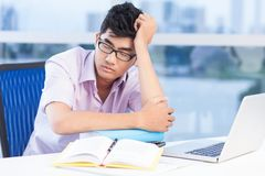 Tired at lesson. Young student falling asleep at lesson Royalty Free Stock Photography