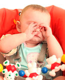 Tired Baby. Tired Little Baby rubs her eyes Stock Photography