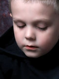 Tired little boy. A little boy falling asleep while sitting up Royalty Free Stock Photos