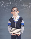 Tired little boy in classroom. Back to school concept. Tired little boy in classroom Stock Photos