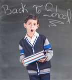 Tired little boy in classroom. Back to school concept. Tired little boy in classroom Royalty Free Stock Image