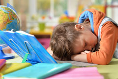 Tired little boy. Fell asleep while he was making his homework Royalty Free Stock Image