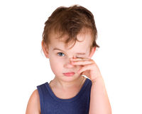 A tired little boy rubbing eyes. Isolated on white Stock Photography