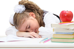 Tired little girl sleep at books Royalty Free Stock Photo