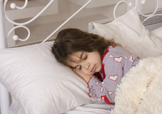 Tired little girl sleeps Royalty Free Stock Images