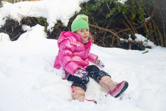 Tired little girl in the snow Royalty Free Stock Image