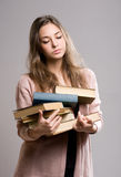 Tired looking student girl. Royalty Free Stock Images
