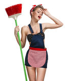 Tired maid standing after spring cleaning with broom Royalty Free Stock Photos