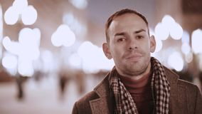 A tired male businessman walks down a winter street. Slow motion, camera stabilizer shot, male portrait stock video