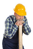 Tired male engineer holding a lath - isolated background Royalty Free Stock Image