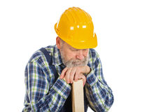 Tired male engineer holding a lath - isolated background Royalty Free Stock Photos