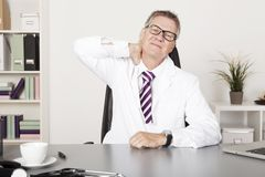 Tired Male Medical Doctor Stock Image