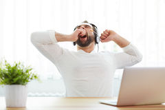 Tired male operator with headset Stock Image