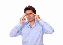 Tired male standing with a tension headache Stock Photo