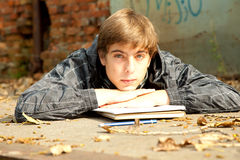 Tired male student. Learning in the park Royalty Free Stock Photos