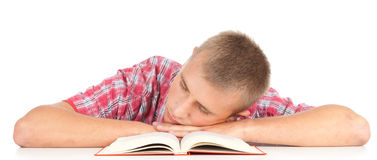 Tired male student with book Royalty Free Stock Photos