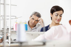 Tired Male Tailor Sitting In Sewing Factory Royalty Free Stock Photos