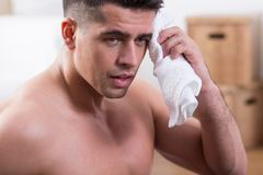Tired male after training. Image of tired male after training with towell Royalty Free Stock Image