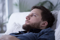Tired male unable to fall asleep Royalty Free Stock Photos