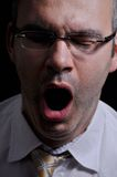 Tired man. This picture represents a tired man, while yawning Royalty Free Stock Images