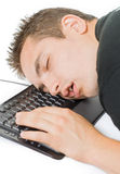 Tired man. Young tired man sleeping on the keyboard Stock Photos