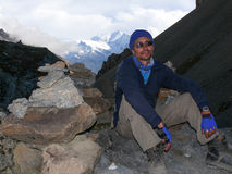 Tired man and Annapurna view in Thorong High Camp, Nepal Stock Images