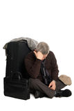 Tired man in anticipation of landing on aircraft. Tired of waiting for a mature man landing on the aircraft sitting on the floor Royalty Free Stock Photos