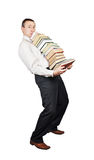 Tired man bears the big pile of books Stock Image