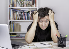 Tired man being overloaded at work Royalty Free Stock Image