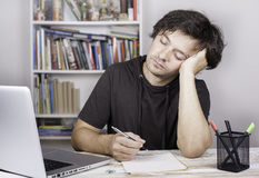 Tired man being overloaded at work Royalty Free Stock Photo