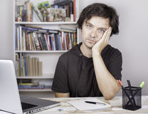 Tired man being overloaded at work Royalty Free Stock Photography