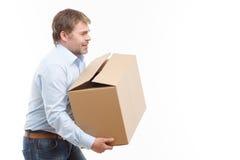 Tired man bringing box Royalty Free Stock Photos