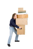 Tired man carrying many cardboard boxes royalty free stock photos