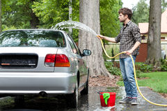 Tired man cleaning car Royalty Free Stock Images