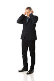 Tired man covering ears with hands Royalty Free Stock Photos