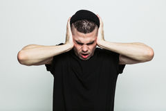 Tired man covering his ears Stock Images