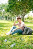Tired man after crouching to waste in the park Royalty Free Stock Image