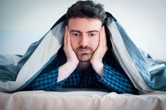 Tired man don`t want to wake up royalty free stock photo