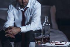Tired man drinking alcohol stock photos